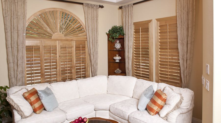 Sunburst Arch Ovation Wood Shutters In Philadelphia Living Room
