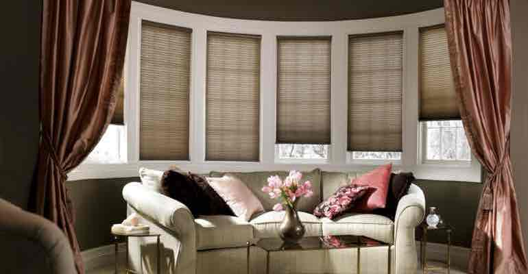 Adjustable cellular shades in parlour bow window.