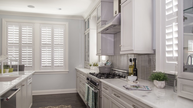 Plantation shutters in Philadelphia kitchen with modern appliances.