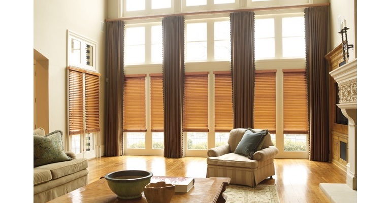 Philadelphia great room with wooden blinds and full-length drapes.