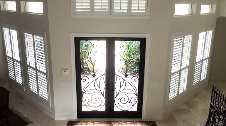 Philadelphia foyer with glass doors and plantation shutters