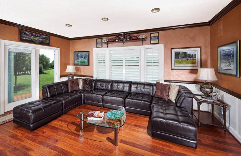 Philadelphia basement with sliding doors and plantation shutters.
