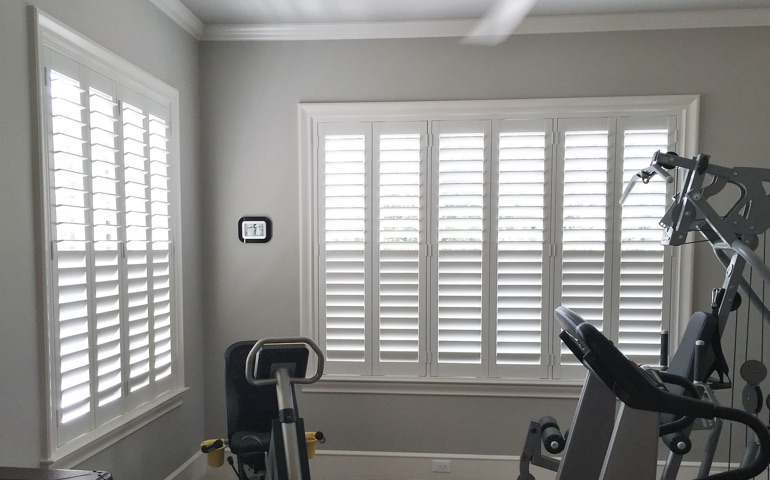 Philadelphia exercise room with shuttered windows.