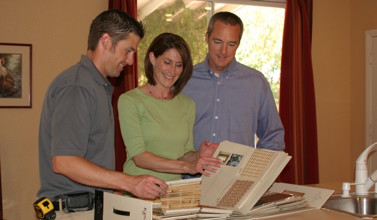 People choosing between samples of window treatments.