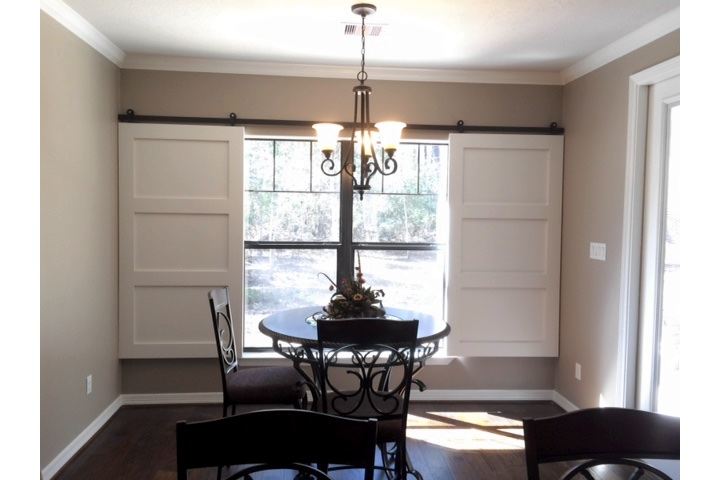 Philadelphia dining room with white barn door shutters.