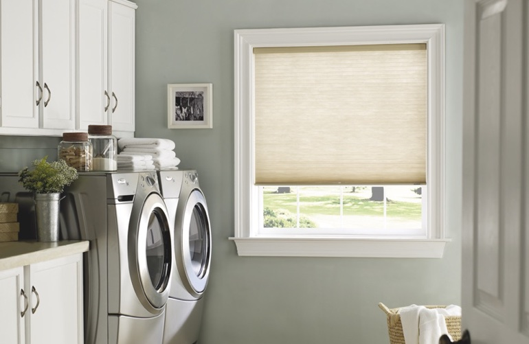Philadelphia laundry room with tan window shades.