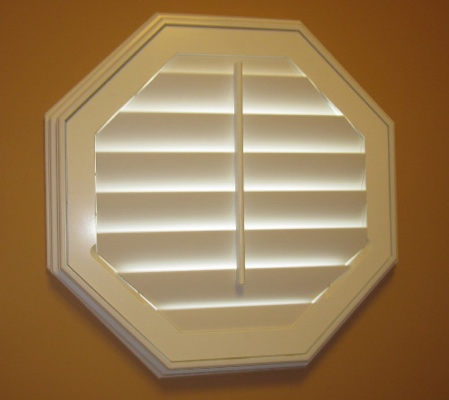 Philadelphia octagon window with white shutter
