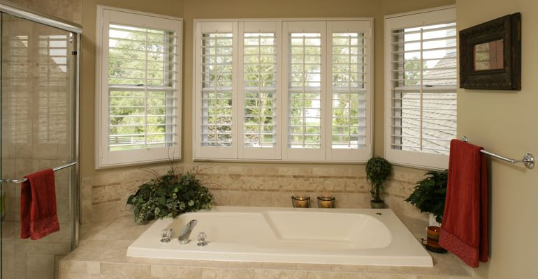 Plantation shutters in Philadelphia bathroom.