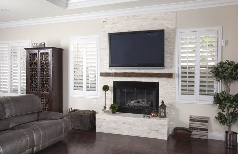 White plantation shutters in a Philadelphia living room with solid hardwood floors.