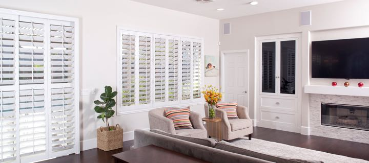 Philadelphia living room in white with plantation shutters.