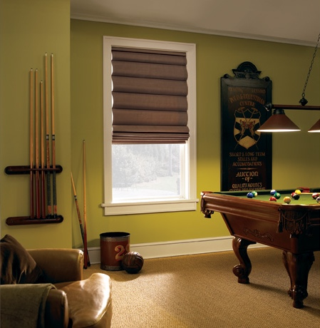 Roman shades in Philadelphia game room with green walls.