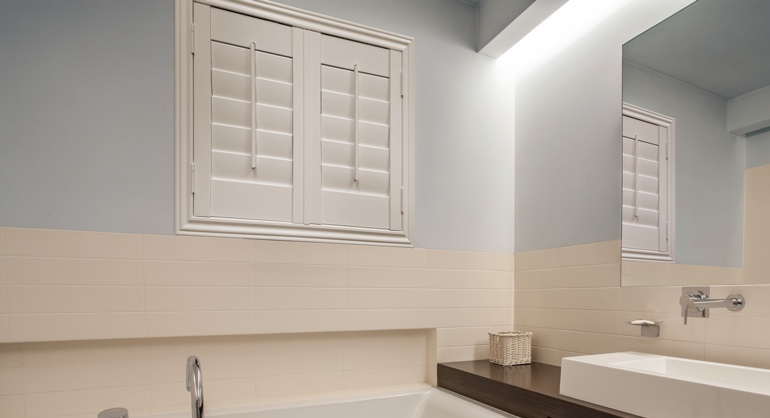 Studio waterproof shutters in Philadelphia bathroom.