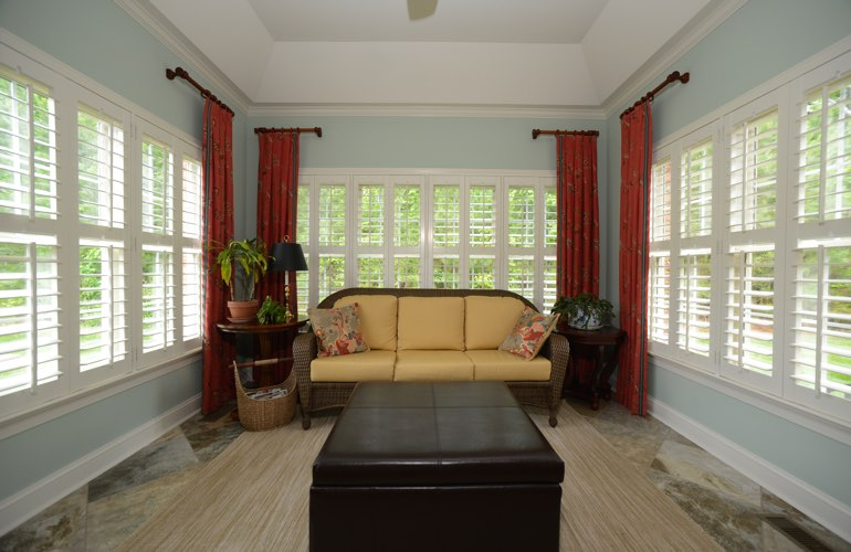 Philadelphia sunroom with classic window shutters.