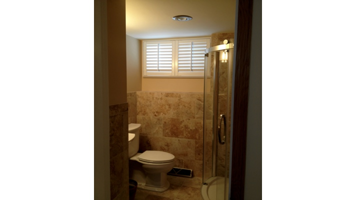 Shutters on basement bathroom window