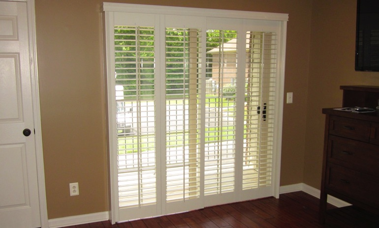 Philadelphia sliding door bifold shutters in living room