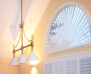 Philadelphia arched eyebrow window with plantation shutter