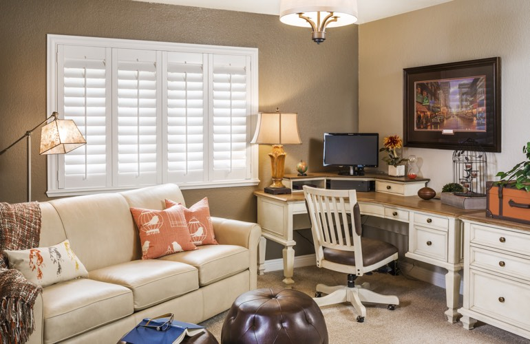 Philadelphia home office with white window shutters.