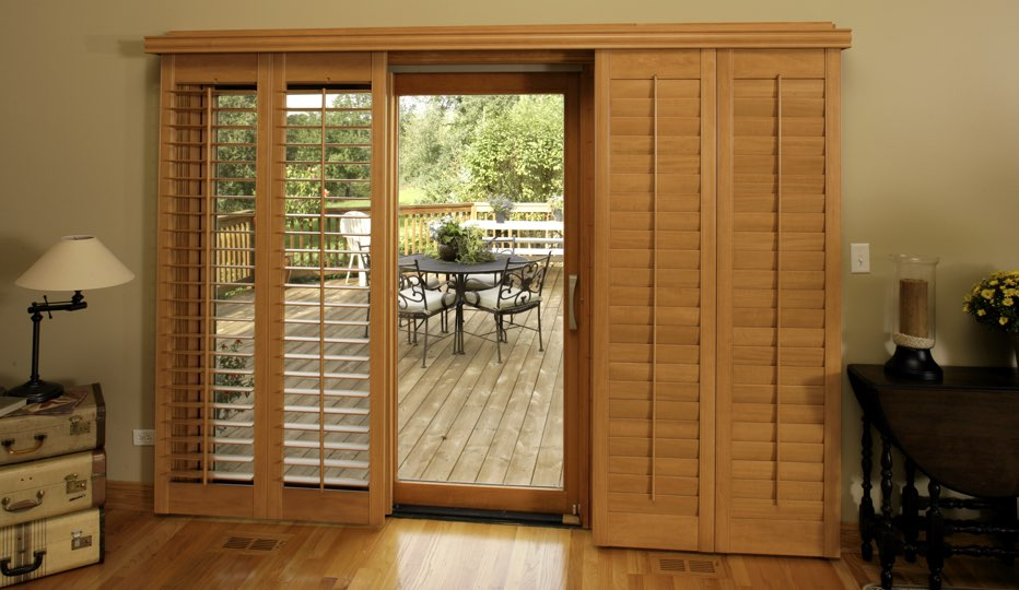 Bypass wood patio door shutters in Philadelphia living room