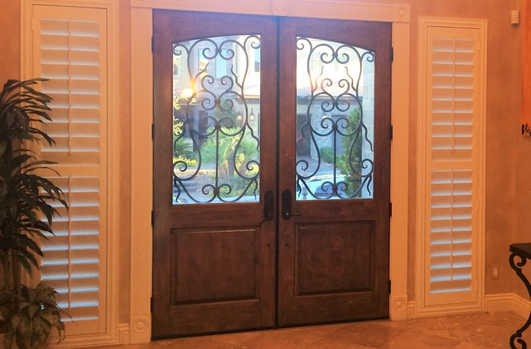 Sidelight window shutters in Philadelphia entryway