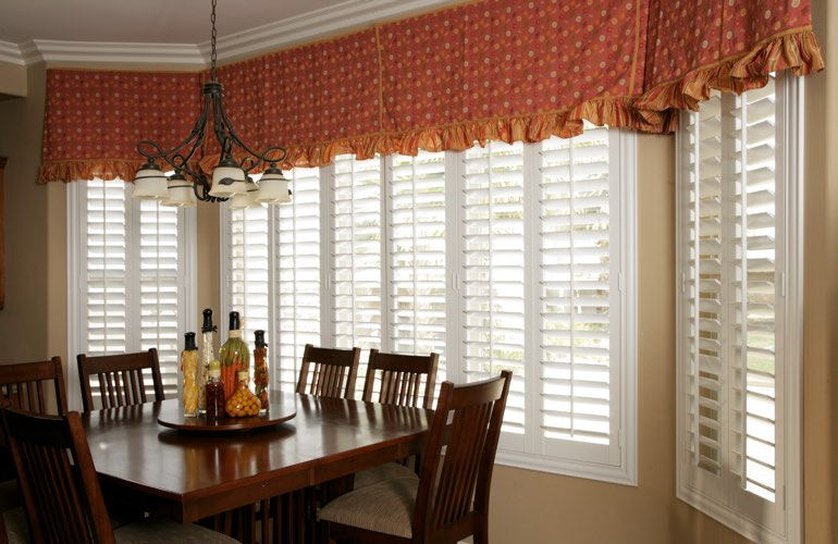 Wide kitchen windows with plantation shutters